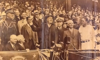 American President Franklin D. Roosevelt (1882 - 1945) prepares to throw out the first ball to open the baseball season before a game at Griffith Stadium, Washington DC, April 24, 1934. Among those pictured are, seated from second left, Presidential Secretary Marvin McIntyre (1878 - 1943), politican James Farley (1888 - 1976), and financier Bernard Baruch (1870 - 1965), and, standing President Roosevelt, Captain Walter N. Vernon, baseball team owner and manager (and stadium namesake) Clark Griffith (1869 - 1955), and baseball player/managers Joe Cronin (1906 - 1984), and Bucky Harris (1896 - 1977). In the game, home team the Washington Senators lost to the Boston Red Sox. Photo courtesy of the Baruch College Archives.