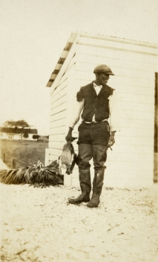 This photo, taken around 1910,  features a man believed to be George Shubrick, a skilled hunting guide and boatman and descendant of persons enslaved at Hobcaw. Guides were expert not only in knowing where and when to shoot, but they had to closely watch the kill drop. Guides were usually able to row to and collect every kill – often, prior to federal regulation, a total of 100 ducks by late morning.