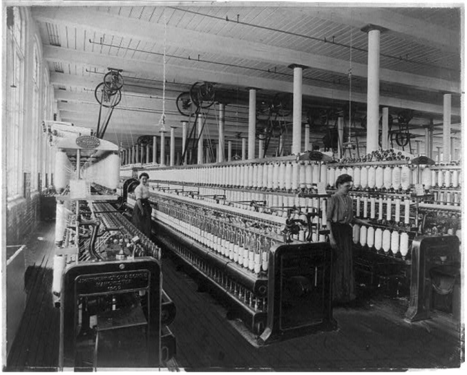 Textile factory with two women at machines, 1910 - LOC